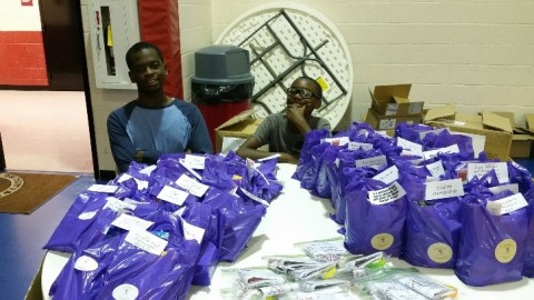 MSF members, Jaylen(l) and Ty(r) James, man the MSF table at the Back to School Bash